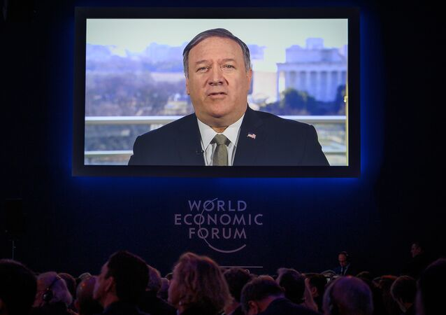 U.S. Secretary of State Mike Pompeo is seen on a screen during his address via satellite at the World Economic Forum (WEF) annual meeting, on January 22, 2019 in Davos, eastern Switzerland.