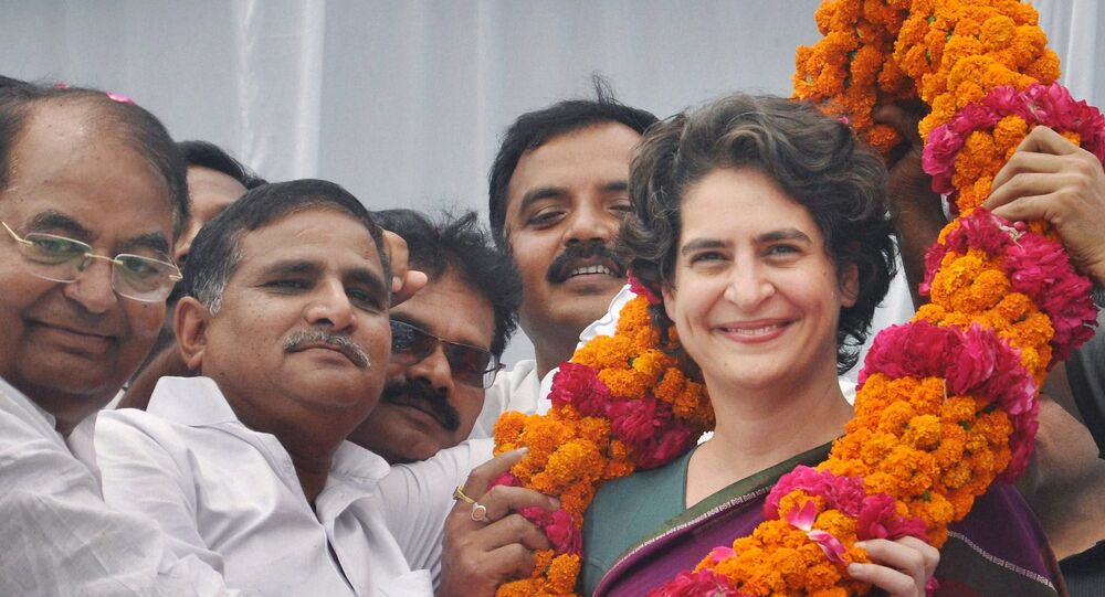 Priyanka Vadra, daughter of Congress party president Sonia Gandhi, receives a floral garland from supporters during an election campaign in her mother's constituency of Rae Bareli, India, Wednesday, April 23, 2014.