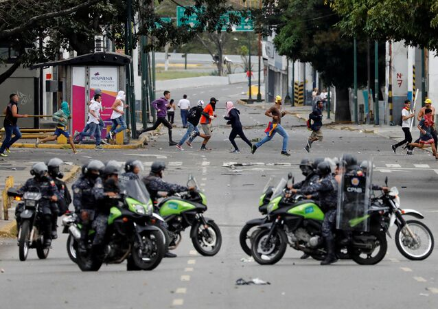 Police secure the area during a protest against Venezuelan President Nicolas Maduro's government in Caracas, Venezuela January 23, 2019.