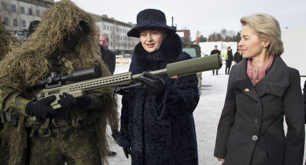 German Defense Minister Ursula von der Leyen, right, and Lithuania's Presidend Dalia Grybauskaite speaks with a soldier during the NATO enhanced forward presence battalion welcome ceremony at the Rukla military base some 130 km (80 miles) west of the capital Vilnius, Lithuania, Tuesday, Feb. 7, 2017
