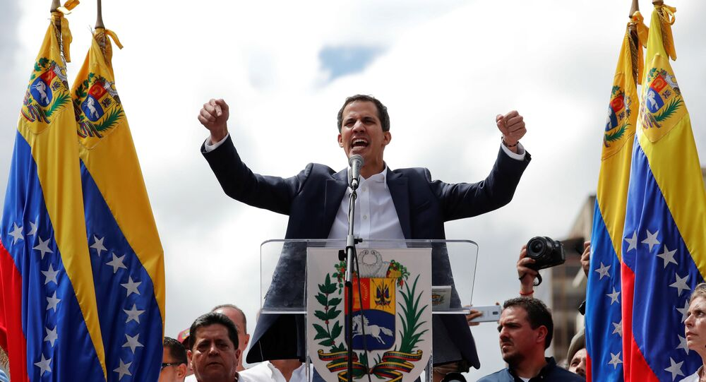 Juan Guaido, President of Venezuela's National Assembly, reacts during a rally against Venezuelan President Nicolas Maduro's government and to commemorate the 61st anniversary of the end of the dictatorship of Marcos Perez Jimenez in Caracas, Venezuela January 23, 2019