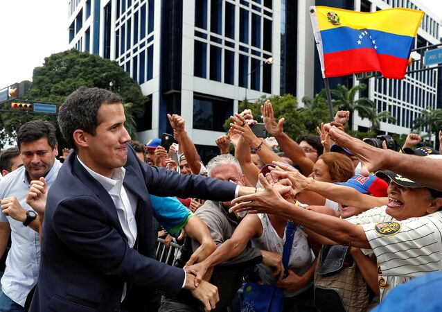 Juan Guaido, President of Venezuela's National Assembly, greets supporters during a rally against Venezuelan President Nicolas Maduro's government and to commemorate the 61st anniversary of the end of the dictatorship of Marcos Perez Jimenez in Caracas, Venezuela January 23, 2019