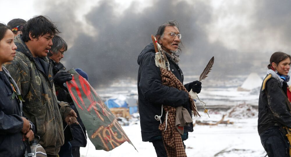 Nathan Phillips (C) marches with other protesters out of the main opposition camp against the Dakota Access oil pipeline near Cannon Ball, North Dakota, U.S., February 22, 2017. Picture taken February 22, 2017