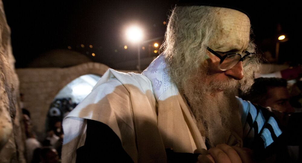 Rabbi Eliezer Berland leaves after praying at Joseph's Tomb in the West Bank city of Nablus, early Monday, May 30, 2011