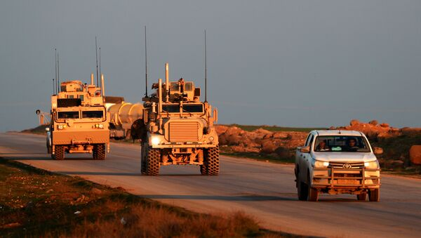 US Marine Corps tactical vehicles are escorted by a Syrian Democratic Forces (SDF) pickup truck along a road near the town of Tal Baydar in the countryside of Syria's northeastern Hasakeh province on December 21, 2018 - Sputnik International