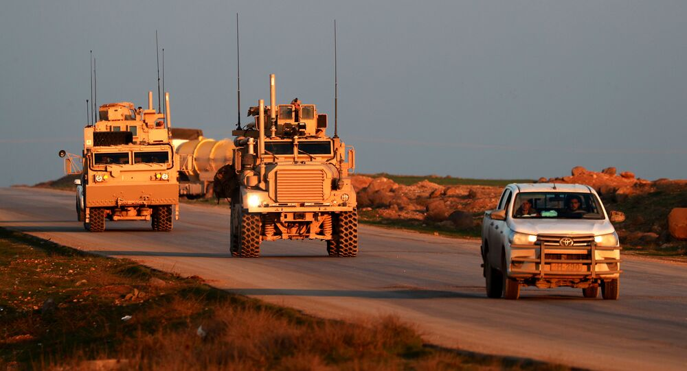 US Marine Corps tactical vehicles are escorted by a Syrian Democratic Forces (SDF) pickup truck along a road near the town of Tal Baydar in the countryside of Syria's northeastern Hasakeh province on December 21, 2018