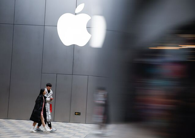 People walk past an Apple store in Beijing, China January 7, 2019