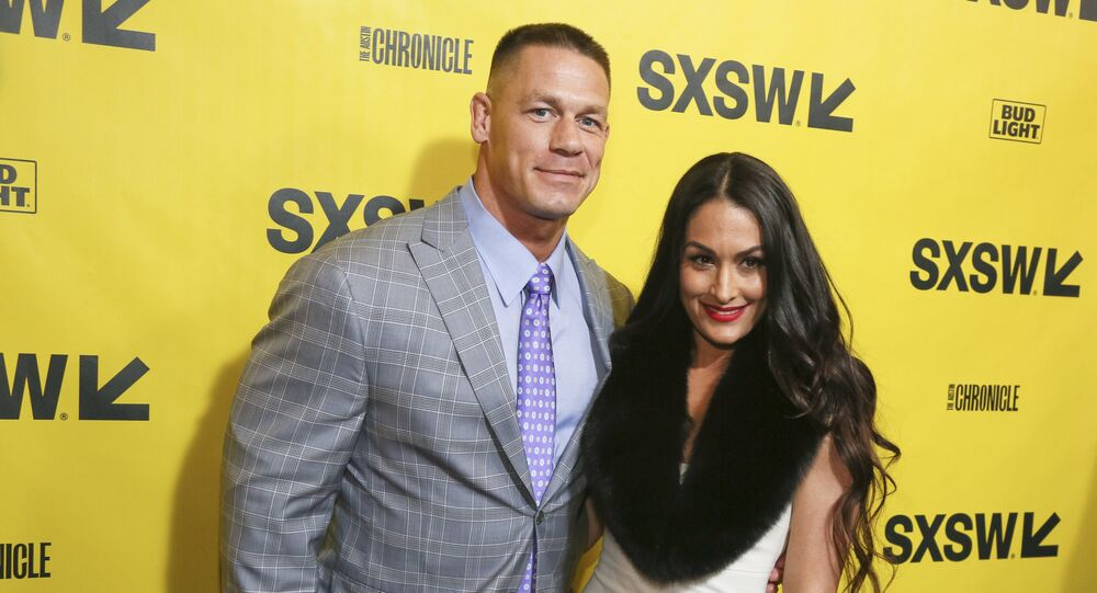 John Cena and his fiancé, Nikki Bella, arrive for the world premiere of Blockers during the South by Southwest Film Festival at the Paramount Theatre on Saturday, March 10, 2018, in Austin, Texas