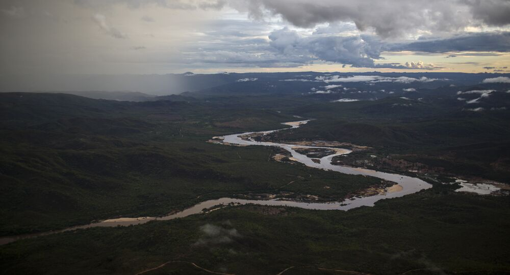 In this Nov. 18, 2015 photo, the Jequitinhonha River snakes across the landscape near Areinha, Minas Gerais state, Brazil.