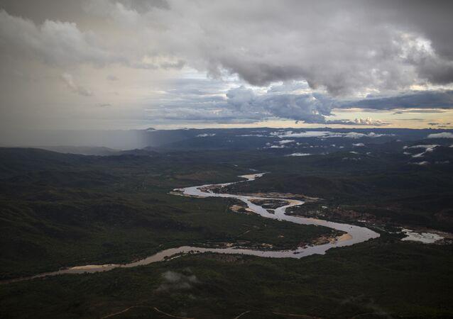 In this Nov. 18, 2015 photo, the Jequitinhonha River snakes across the landscape near Areinha, Minas Gerais state, Brazil.