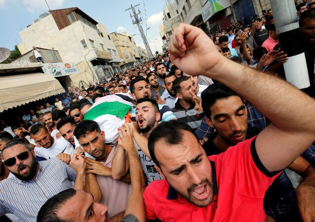 Mourners carry the body of Palestinian woman Aisha al-Rawbi during her funeral in the town of Biddya near Nablus in the occupied West Bank October 13, 2018