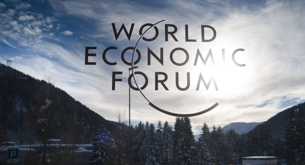 The sign of the World Economic Forum, WEF, is displayed at an entrance door at the congress center at the eve of the meeting in Davos, Sunday, Jan. 20, 2019.