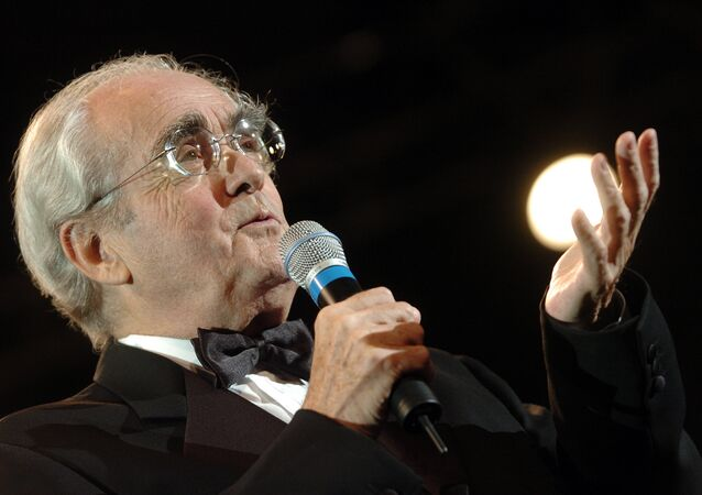 In this file photo taken on October 23, 2004 French music composer Michel Legrand speaks on stage during the festival international de Musique et Cinema in Auxerre.