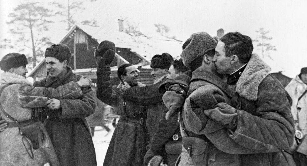 Soldiers celebrate after completing an operation to partially break the encirclement of Leningrad, January 18, 1943.