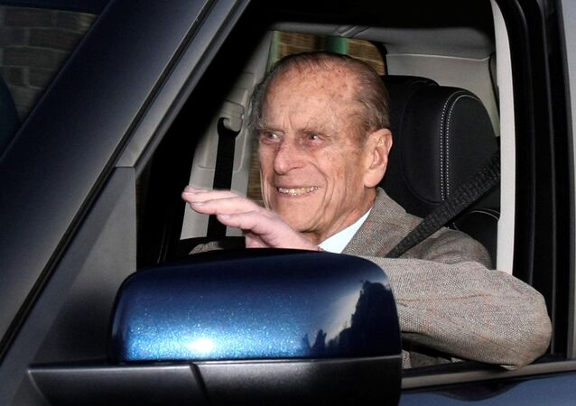 FILE PHOTO: Britain's Prince Philip is driven away from Papworth Hospital in southern England December 27, 2011.
