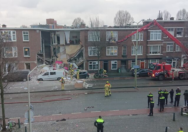 Part of residential building collapses after an explosion in Hague.