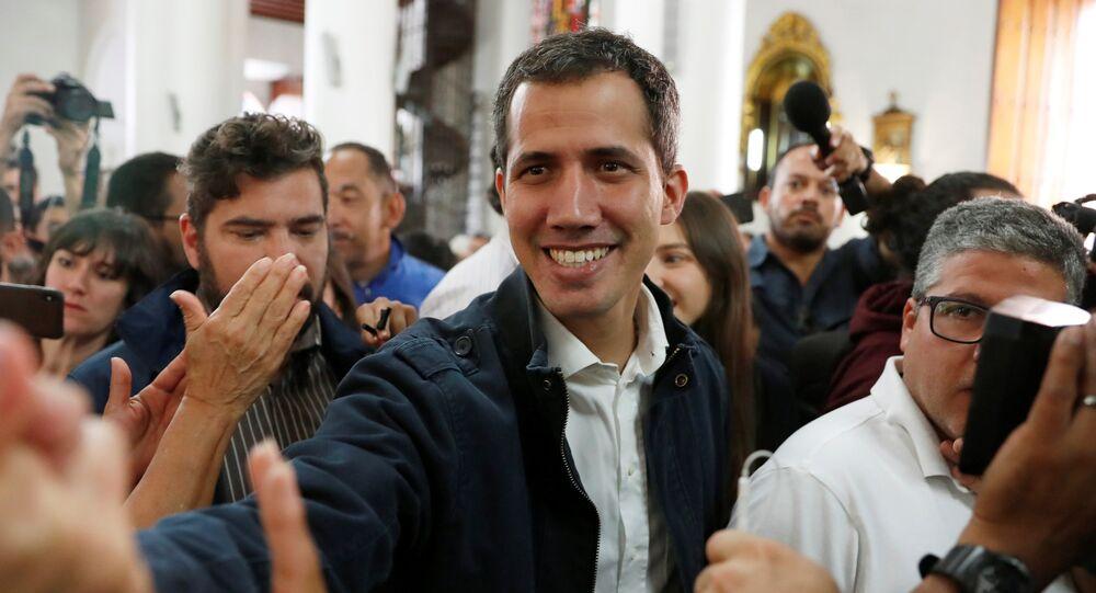 Venezuelan opposition leader and self-proclaimed interim president Juan Guaido arrives to attend a holy mass in Caracas, Venezuela, January 27, 2019