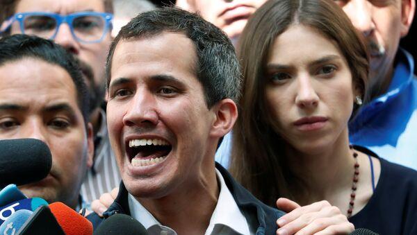 Venezuelan opposition leader and self-proclaimed interim president Juan Guaido accompanied by his wife Fabiana Rosales, speaks to the media after a holy mass in Caracas, Venezuela, January 27, 2019 - Sputnik International