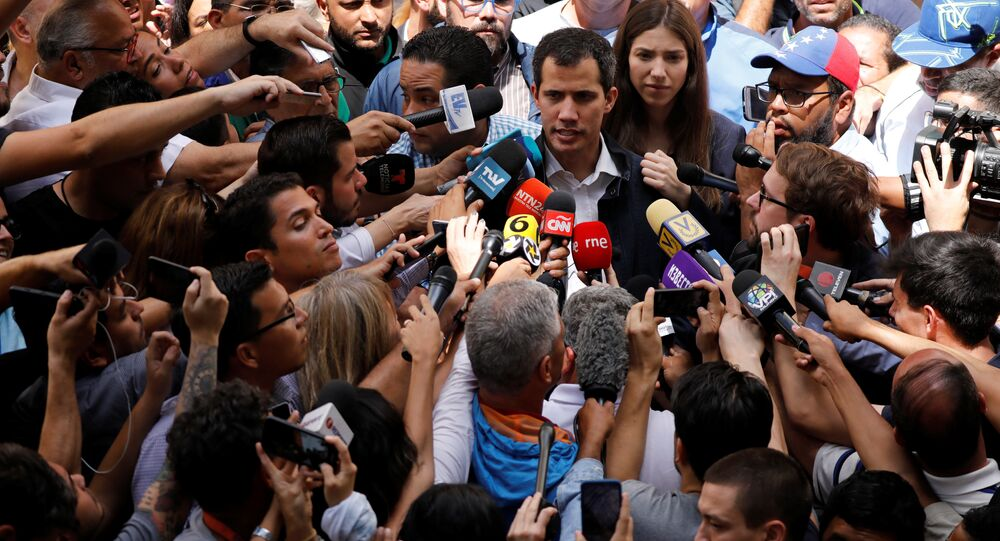Venezuelan opposition leader and self-proclaimed interim president Juan Guaido accompanied by his wife Fabiana Rosales, speaks to the media after a holy Mass at a local church in Caracas, Venezuela, January 27, 2019