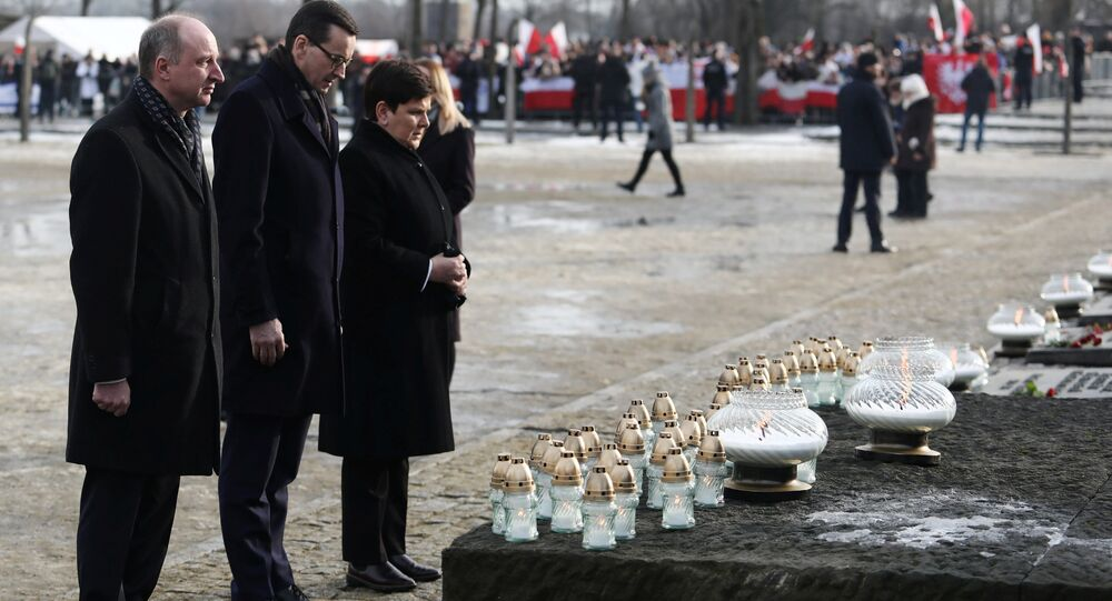 Polish Prime Minister Mateusz Morawiecki, deputy Prime Minister Beata Szydlo and Undersecretary of State at the Chancellery of the President of Poland Wojciech Kolarski place candles at the Monument to the Victims during a commemoration event at the former Nazi German concentration and extermination camp Auschwitz II-Birkenau, during the ceremonies marking the 74th anniversary of the liberation of the camp and International Holocaust Victims Remembrance Day, near Oswiecim, Poland, January 27, 2019