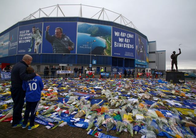 Football fans outside Cardiff City's stadium, where a mass of flowers and other tributes have been placed since Emiliano Sala's plane vanished