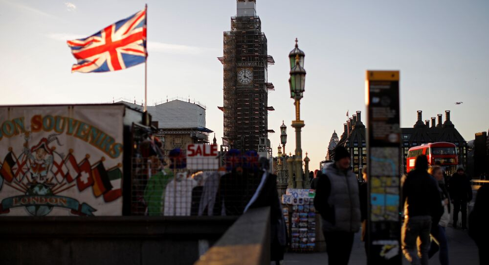 A Union flag flies from a pole in front of the Elizabeth Tower, commonly known as Big Ben, near the Houses of Parliamnet in central London on January 28, 2019