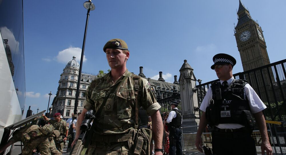 British Army soldiers board a bus outside the Palace of Westminster, comprising the Houses of Parliament and the House of Lords, in central London, on May 25, 2017