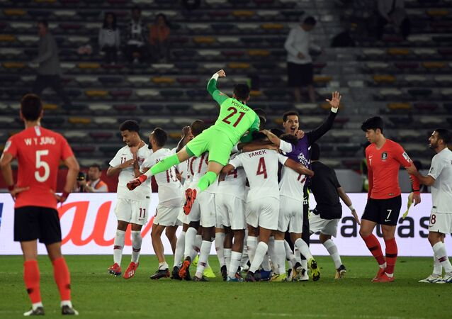 Qatar's players celebrate after they shocked South Korea by beating them in the Asia Cup quarter final
