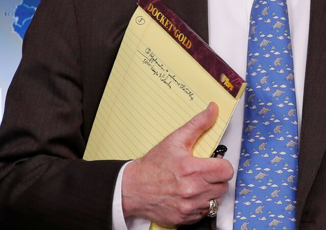 U.S. National Security Adviser John Bolton holds a writing pad with a written note that reads 5,000 troops to Colombia, while he waits to address reporters, as the Trump administration announces economic sanctions against Venezuela and the Venezuelan state owned oil company Petroleos de Venezuela (PdVSA) during a press briefing at the White House in Washington, U.S., January 28, 2019
