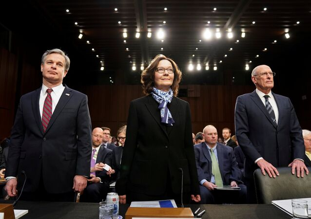 FBI Director Christopher Wray; CIA Director Gina Haspel and Director of National Intelligence Dan Coats arrive with other U.S. intelligence community officials to testify before a Senate Intelligence Committee hearing on worldwide threats on Capitol Hill in Washington, U.S., January 29, 2019.