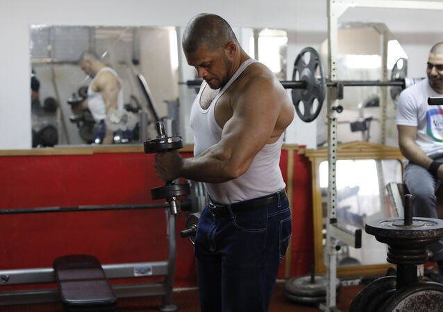 Arab Israeli bodybuilder and Muezzin Ibrahim Masri works out at a gym in the northern Israeli port city of Acre on January 29, 2019.