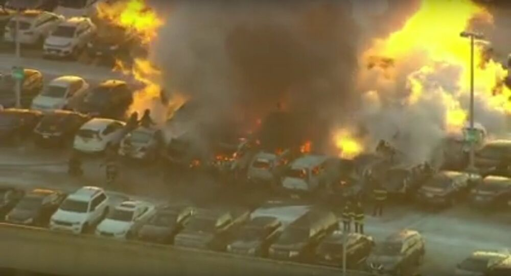 Dozens of vehicles catch fire at N.J. airport parking garage