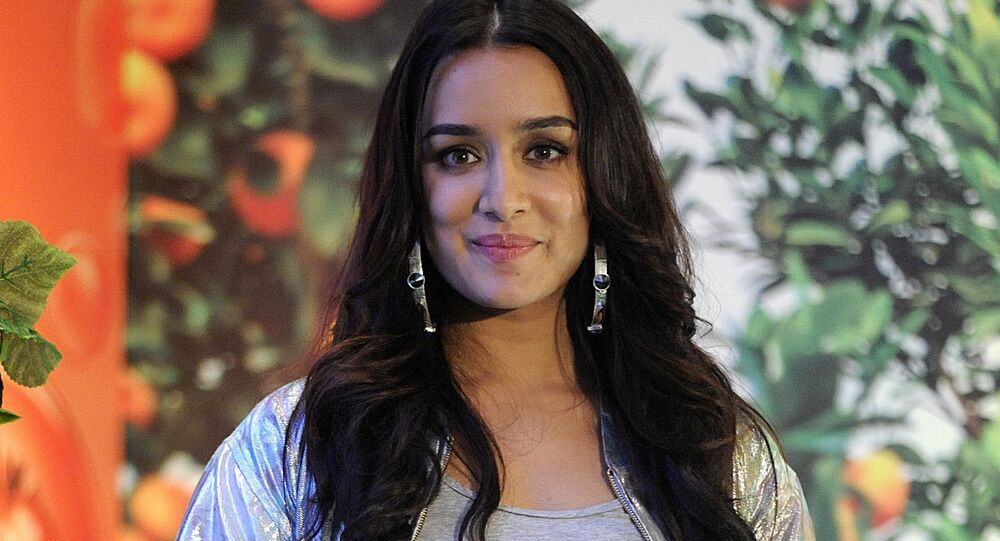 Indian Bollywood actress Shraddha Kapoor poses during a promotional event for beauty products in Mumbai on July 7, 2017