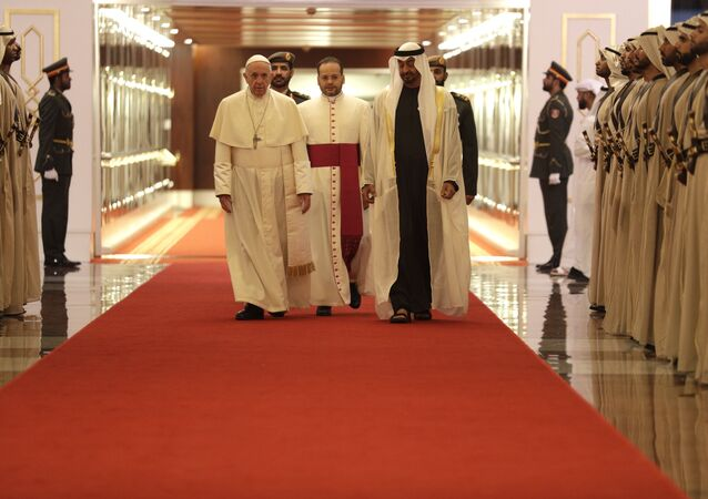 Pope Francis is welcomed by Abu Dhabi's Crown Prince Sheikh Mohammed bin Zayed Al Nahyan, upon his arrival at the Abu Dhabi airport, United Arab Emirates, Sunday, Feb. 3, 2019