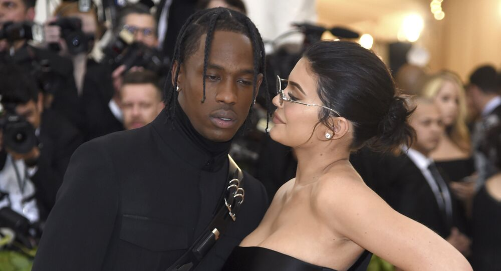 Kylie Jenner, right, and Travis Scott attends The Metropolitan Museum of Art's Costume Institute benefit gala celebrating the opening of the Heavenly Bodies: Fashion and the Catholic Imagination exhibition on Monday, May 7, 2018, in New York