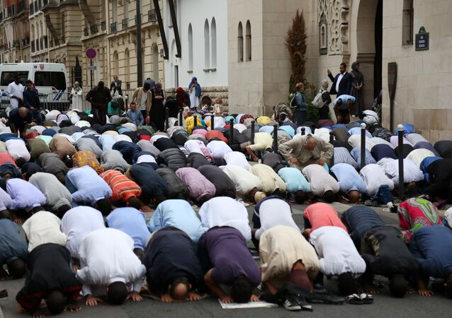 Muslims pray in the street outside The Grande Mosque in Paris on August 21, 2018, as they celebrate the first day of the Islamic Festival of Eid al-Adha. Muslims across the world are celebrating the annual festival of Eid al-Adha or the festival of sacrifice which marks the end of the Hajj pilgrimage to Mecca and commemorates prophet Abraham's readiness to sacrifice his son to show obedience to God