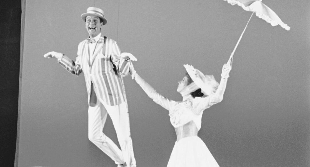 In this June 25, 1963, file photo, Dick Van Dyke, left, is airborne during a dance with Julie Andrews, right, during the filming of Mary Poppins in Los Angeles