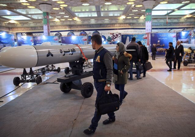 Visitors look at a Hoveizeh 8 cruise missile at a military show marking the 40th anniversary of Iran's Islamic Revolution.