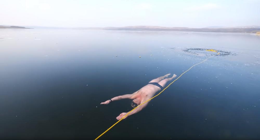 Thrills & Chills: Czech Freediver Swims Under Clear Frozen Lake