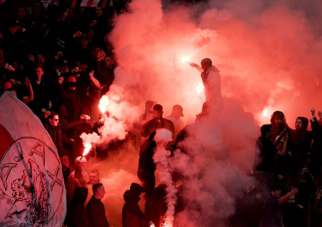 Supporters launch smoke flares during the training session of Ajax Amsterdam on April 1, 2017 in Amsterdam, on the eve of the Dutch Eredivisie football match between Ajax Amsterdam and Feyenoord Rotterdam.