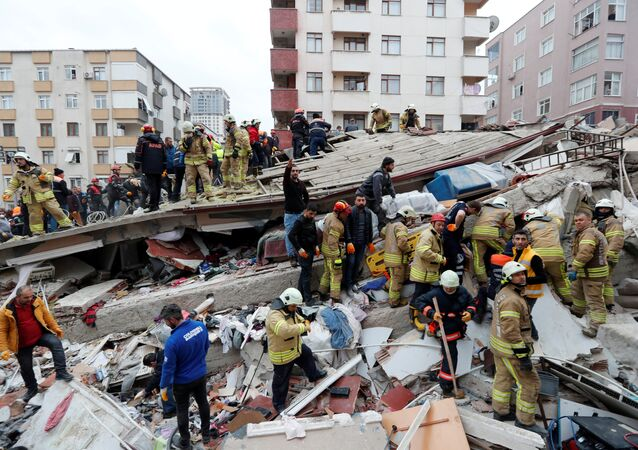 Rescuers work at the site of a collapsed residential building in the Kartal district, Istanbul, Turkey, February 6, 2019.