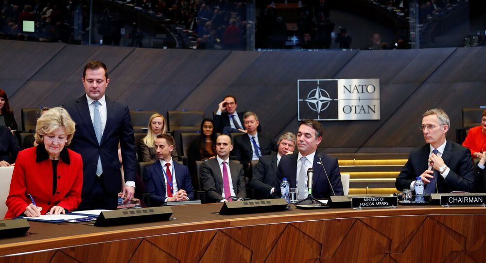 US Ambassador to NATO Kay Bailey Hutchison, Macedonian Foreign Minister Nikola Dimitrov and NATO Secretary General Jens Stoltenberg attend a signature ceremony of the accession protocol between the Republic of North Macedonia and NATO at the Alliance headquarters in Brussels, Belgium February 6, 2019.