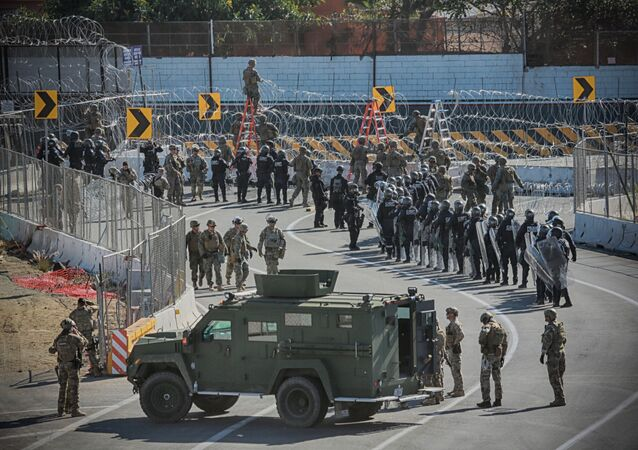 United States Military personel and Border Patrol agents secure the US - Mexico border on November 25, 2018 at the San Ysidro border crossing point south of San Diego, California.