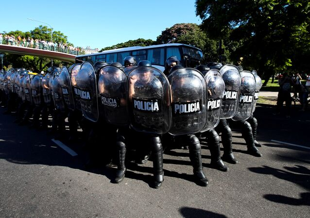 Riot police stand guard after clashes with protesters during a rally in support of Venezuelan President Nicolas Maduro outside the University of Buenos Aires' Law School, in Argentina, February 5, 2019