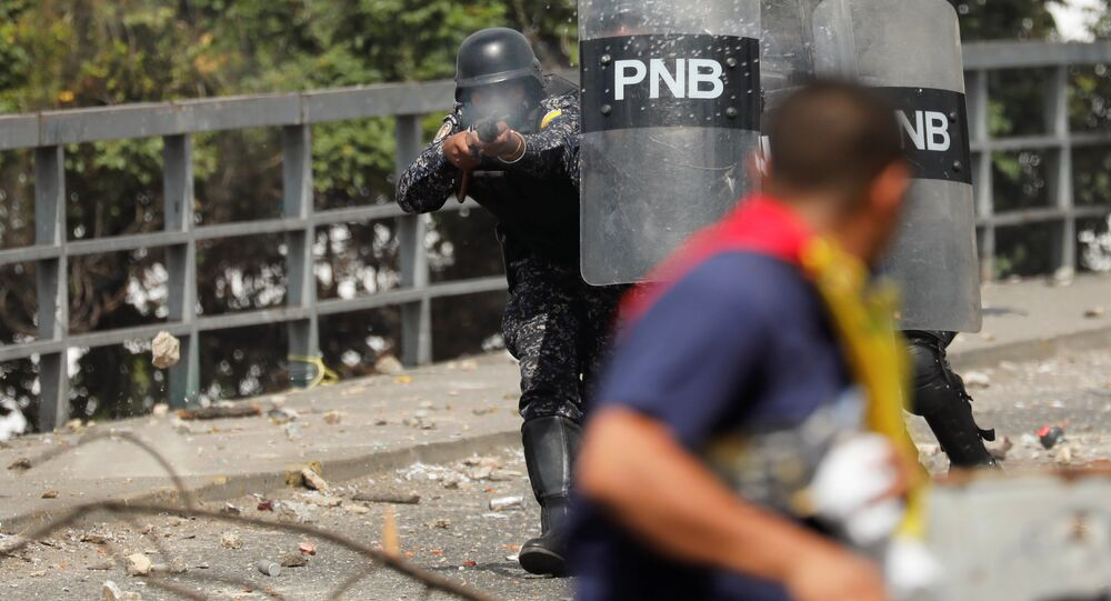 A National Police officer fires rubber bullets during a protest against Venezuelan President Nicolas Maduro's government in Caracas, Venezuela January 23, 2019