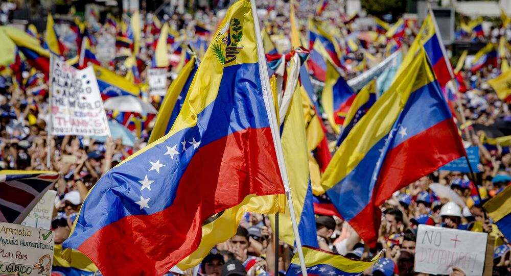 Supporters of Juan Guaido, self-proclaimed Interim President of Venezuela, wave flag during a rally, in Caracas, Venezuela
