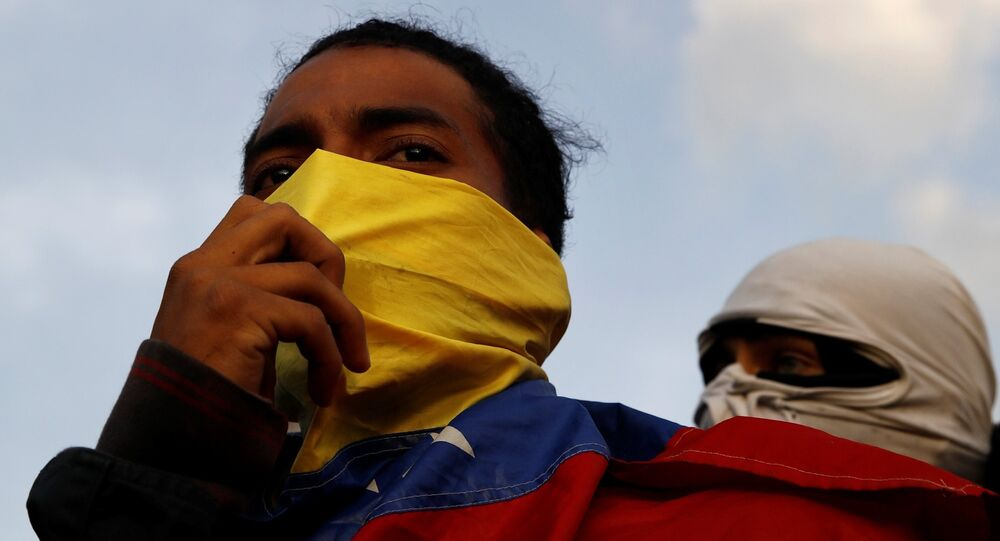 Demonstrators are seen during a protest against Venezuelan President Nicolas Maduro's government in Caracas, Venezuela February 2, 2019