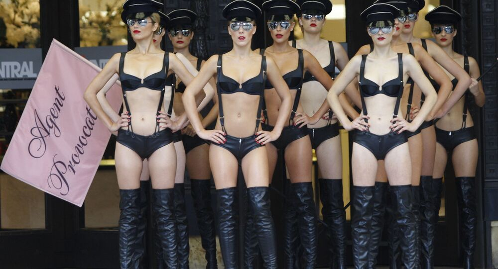 Models display Agent Provocateur's new lingerie collection 'The New World Order' outside a department store in London, Wednesday, Sept. 16, 2009.