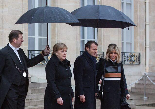 Germany's Angela Merkel and France's Emmanuel Macron at France Armistice Day