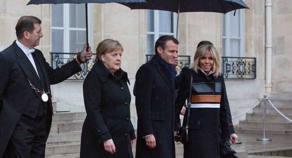 Germany's Angela Merkel and France's Emmanuel Macron at France Armistice Day